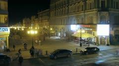 People walk in city center at night near Tanuki restaurant Stock Footage
