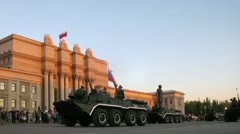 Military vehicles take part in military parade on area Stock Footage