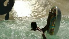 Children having fun in swimming pool - stock footage