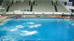 Teams play waterpolo in pool of sports complex, time lapse - stock footage