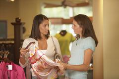 Women discussing clothes in store Stock Photos