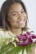 Teenage girl holding a bunch of purple flowers Stock Photos