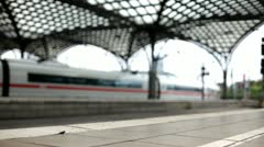 Train station terminal with train exiting Stock Footage