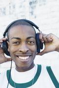 Teenage boy wearing headphones Stock Photos