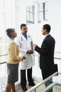 Doctor talking to businesspeople Stock Photos