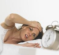 Young woman waking up Stock Photos