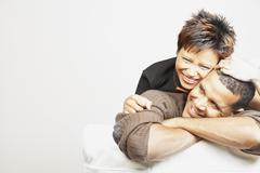 Young couple smiling for the camera Stock Photos