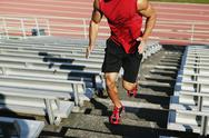 Stock Photo of Male athlete running up steps