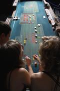 Friends gambling at a casino Stock Photos