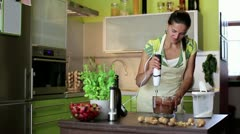 Woman with blender preparing a cake in the kitchen - stock footage