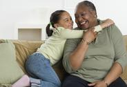 Stock Photo of Senior woman hugging her granddaughter