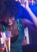 Young woman at a dance club Stock Photos