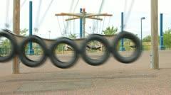 Swing from car wheels Stock Footage