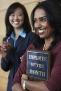 Businesswoman holding Employee of the Month plaque Stock Photos