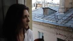 Beautiful woman at a window slider Stock Footage
