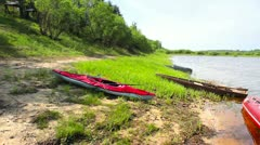 Rubber boat and canoe near the pier on the lake Stock Footage