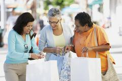 Group of middle-aged woman with shopping bags Stock Photos