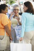 Group of middle-aged women with shopping bags Stock Photos
