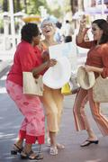 Group of middle-aged woman in the street laughing Stock Photos