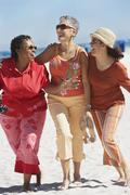 Group of middle-aged women at the beach Stock Photos