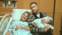 Mother and father with newborn in hospital Stock Footage