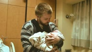 Stock Video Footage of New father with newborn infant