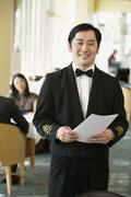 Asian male waiter at upscale restaurant Stock Photos