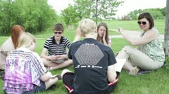 Teaching class outside outdoors Stock Footage