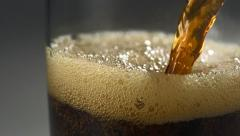 Pouring coke into glass, Slow Motion Stock Footage