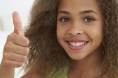Close up of African American girl giving thumbs up Stock Photos