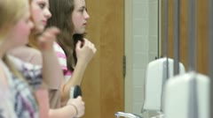Girls in school restroom / bathroom - stock footage
