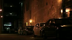 Downtown dark alley man Stock Footage
