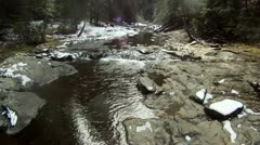 Extreme low level creek flyover Stock Footage