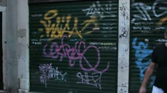 Graffiti on black garage doors (HD) c Stock Footage