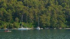 Anchored yachts and sailboats Stock Footage