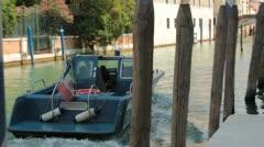 Italian police boat in Venice turning around (HD) c Stock Footage