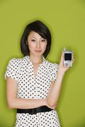 Studio shot of Asian woman holding electronic organizer Stock Photos