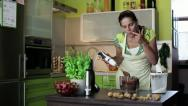 Happy woman mixing and tasting cake dough HD Stock Footage