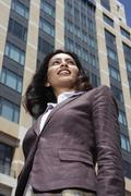 Stock Photo of Low angle view of Indian businesswoman in urban scene