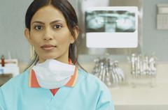 Indian female dental assistant next to x-rays Stock Photos