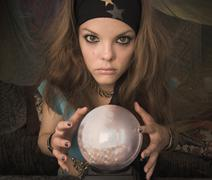 Woman dressed at fortune teller with crystal ball Stock Photos