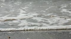 Waves Crash against Pebbles on a Beach Stock Footage
