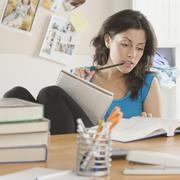 Portrait of Hispanic woman studying Stock Photos