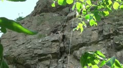 Young athlete does lift the steep cliff Stock Footage