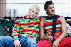 Teenage boys sitting on bench Stock Photos
