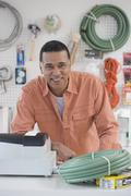 African hardware store owner smiling behind counter Stock Photos