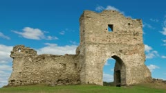 Ruined gates of cossack castle with blue sky and clouds Stock Footage