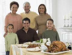 Multi-generational Hispanic family at Thanksgiving table Stock Photos