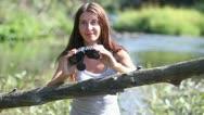 Girl, binoculars Stock Footage