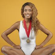 African woman wearing bathing suit and medal Stock Photos